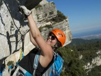 Girl pranticating via ferrata in Mussara