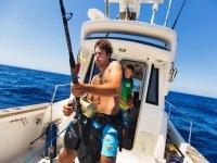 Pescador en barco en Denia