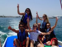 Parasailing among friends in Ibiza