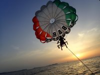 Parascending in Ibiza at sunset