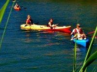 families kayaking on the lake