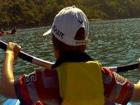boy paddling while sailing