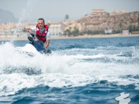 Operating the controls of the jet ski