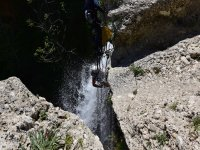 Vertical rappelling in the waterfall