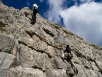 Climbing on Unquera rock wall