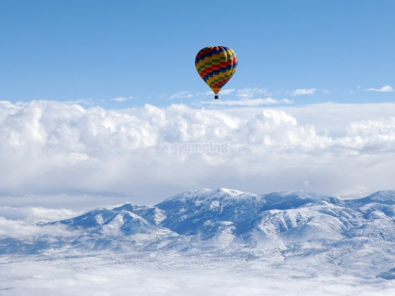 Balloon with mountainous sights as the background