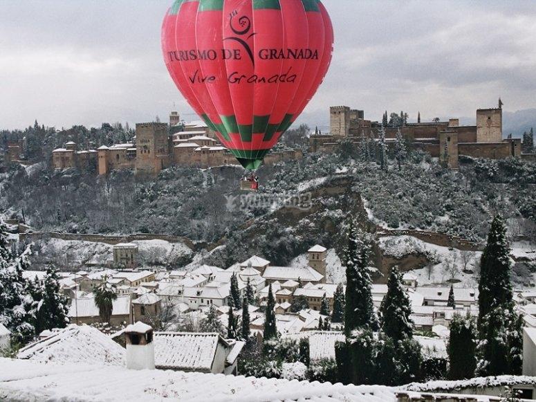 Balloon flight over the snowy Alhambra