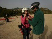 preparing the passenfger with the paraglide equipment