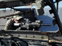 Sniper behind the vehicle