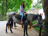Girl by horse in Taramundi