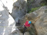 Rappel in a dry ravine