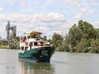 Boat passing through the Sevillano River