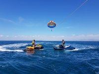 Jet skis under parasailing
