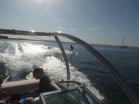 Wakeboard con embarcacion de apoyo