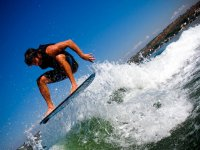 Jumping on a wakesurf board