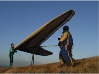 Helping to prepare the hang-glider