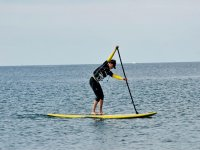 Practicando paddle surf a nivel profesional