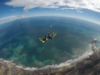 Formation of three skydivers
