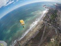 Open parachute over the coast