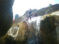 Jumping into the water from the waterfall