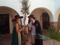 Couple with cape and hat in typical patio