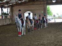 Alumnos de equitacion en el Catllar