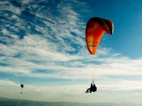 Two flights in paragliding with the sky full with clouds
