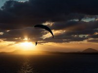 Flying over the sea in paragliding