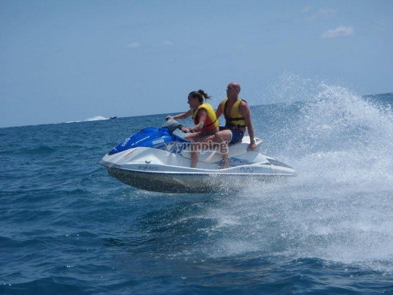Riding a jet ski in Ibiza