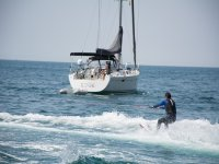 Water ski next to the sailboat