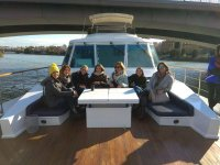 Friends in the boat trip at Seville