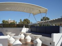 Sofas and tables of the boat in Guadalquivir
