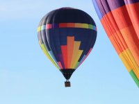 Colored balloon in flight