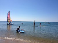Learn to windsurf and sailboat in Huelva