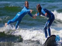 Surfers shaking hands