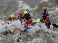 Raft covered by whitewater