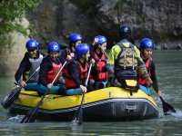 Group of children paddling in Huesca river