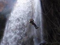 Rapel flown in the waterfall