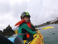 Kid on a kayak in the coast of Cantabria