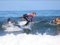 Alumno de surf en Las Americas