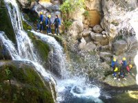 Friends practicing canyoning