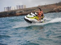 Turning on the jet ski on the Tinerfena coast