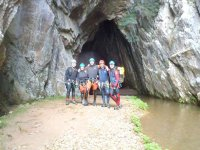 at the entrance of the cave