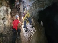 Helping the colleague in the cave