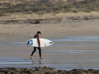 Walking on the beach with the board