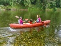 Family sharing canoe