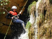 rappel with waterfall