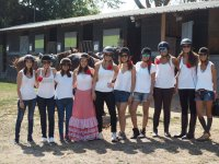 Group of friends in the horse riding farm