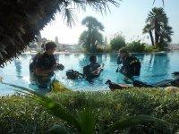Bautizo con equipo en piscina