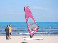 Learning the windsurfing position in the sand